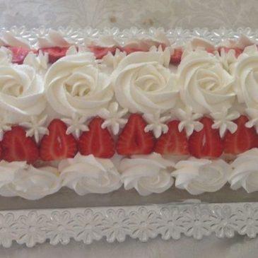 Brazo gitano relleno de crema pastelera y fresas